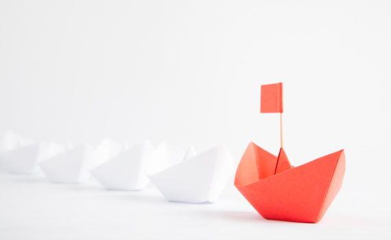Red Boat Leadership Concept on White Background